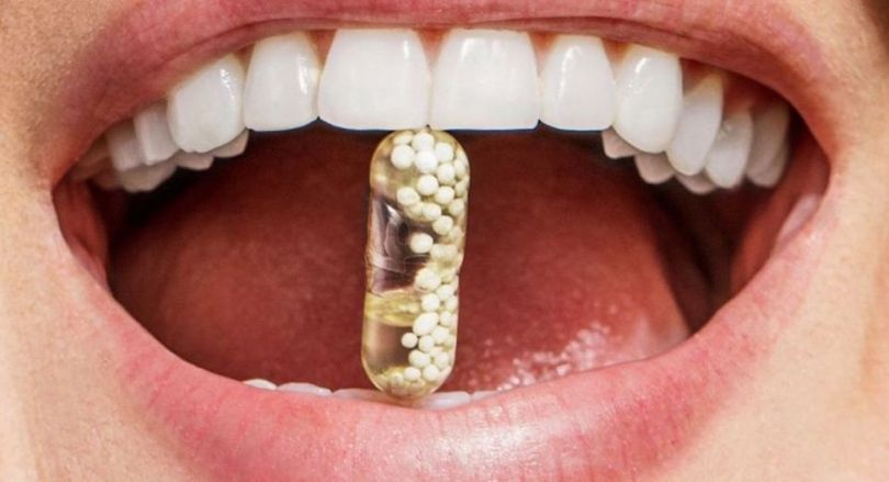 Ritual pill in mouth of woman