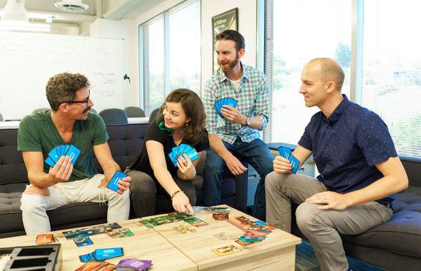 Versus engineers play a board game together