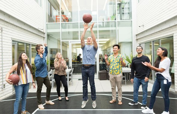 Tinder's engineering team shooting some hoops at their office