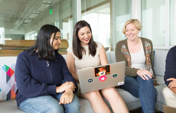 Tinder's engineering team collaborating in the office